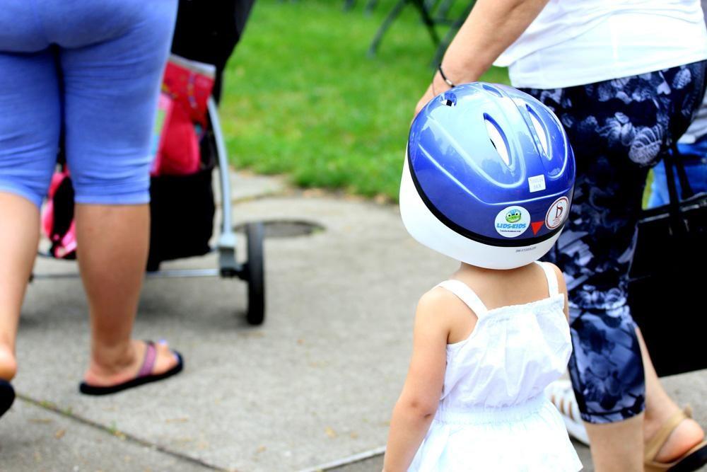 child-wearing-helmet-lids-for-kids-grand-rapids